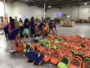 FGT warehouse volunteer services - sorting backpacks