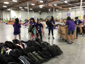 FGT warehouse volunteering service - sorting backpacks