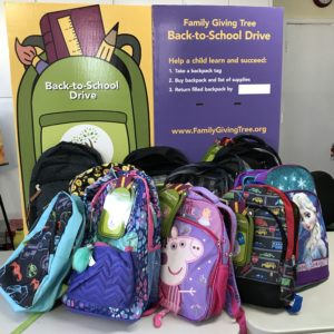 2017 GATA members backpack donation in support of Family Giving Tree